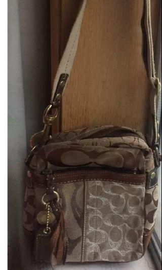 Used coach sling bag authentic