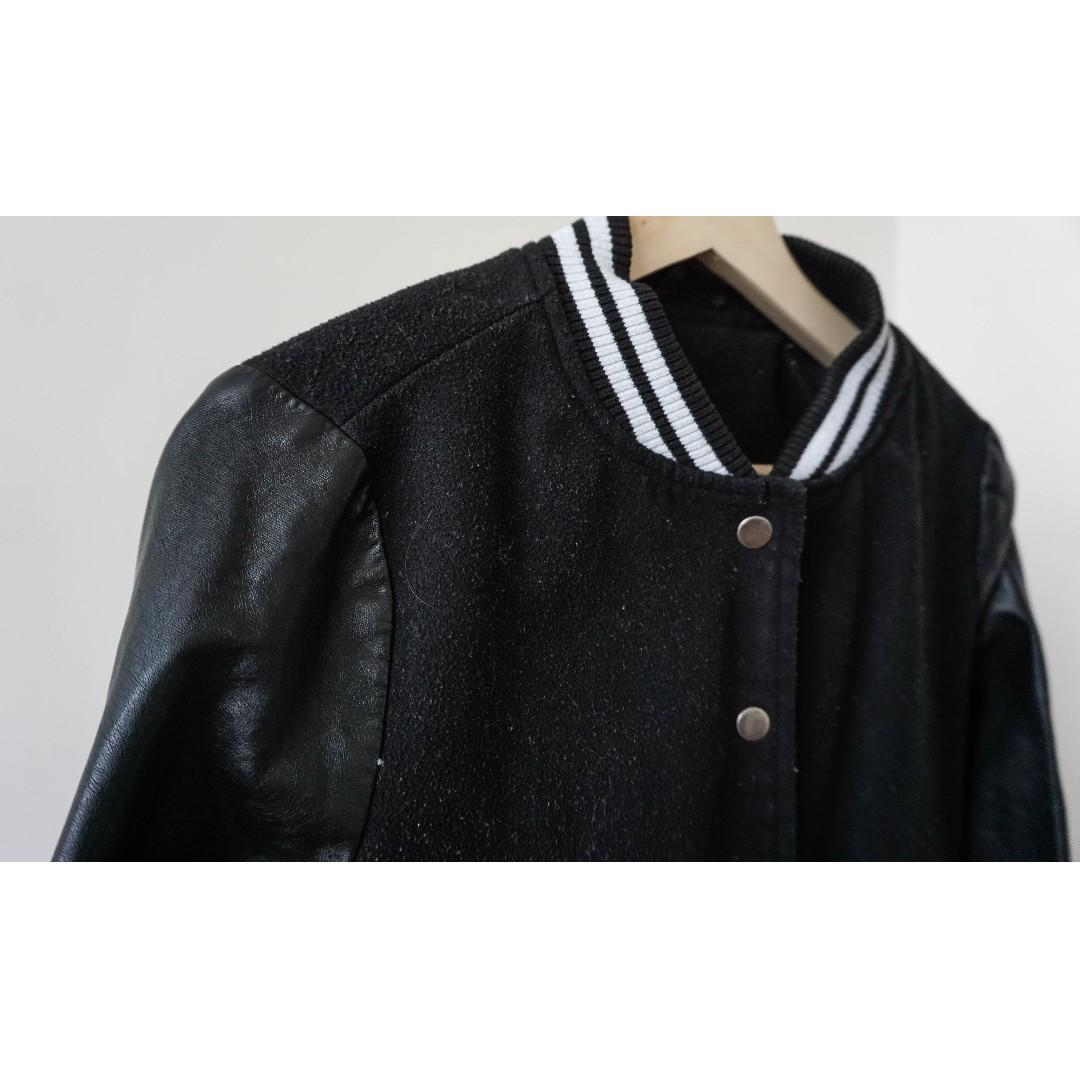 Black faux leather and fleece thick sweater with buttons