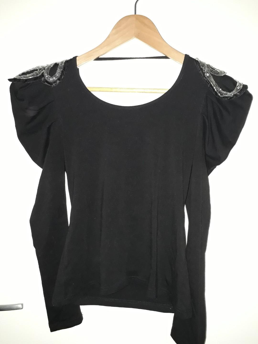 Black long sleeve top with lace back and embellished padded shoulders