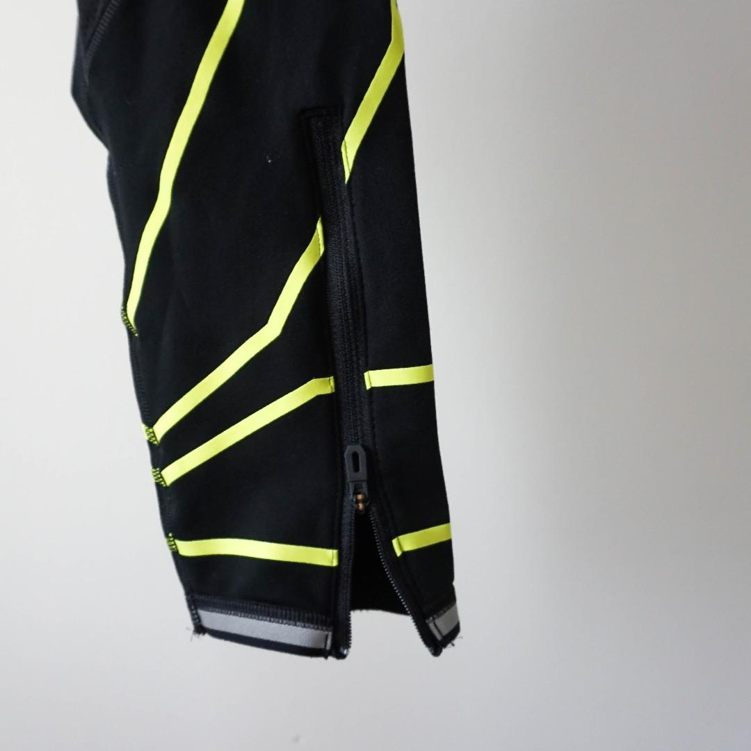 Reebok black high performance thermal fleece legging with neon strips and reflective hem (xs/s)