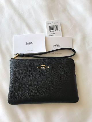 New, authentic COACH leather pouch