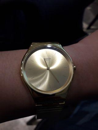 Swatch gold womens watch