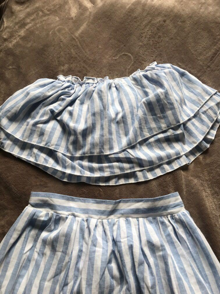 Top and skirt (high slip cut on side but the skirt has built in short) size small