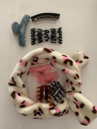 Assorted hair items. Hair clips. Hair clamps. Adjustable head band.