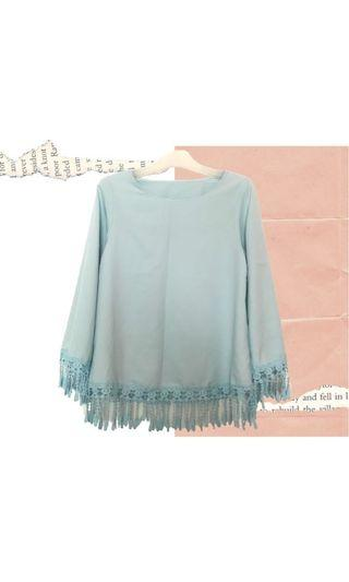 Blouse in baby blue