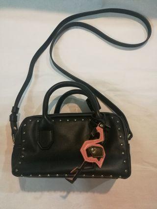 Zara sling bag with flamingo keychain
