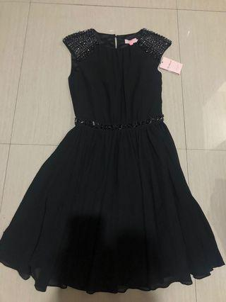 Black dress by Ted Barker
