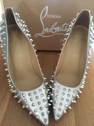 🚚 Christine Louboutin size 39 silver spike heels