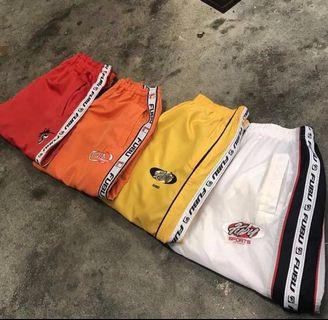 red FUBU track pants