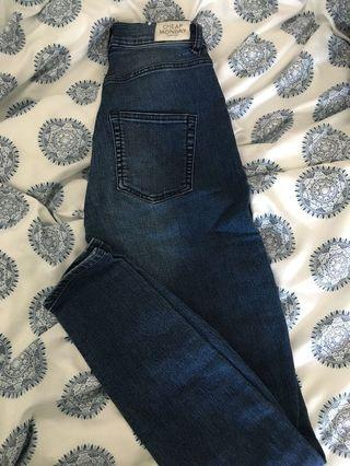 Skinny cheap monday jeans with rip detail size 26-27