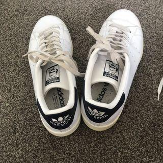 white and blue Stan Smiths