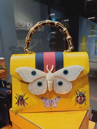 Gucci Falena totem, with butterfly embellishment