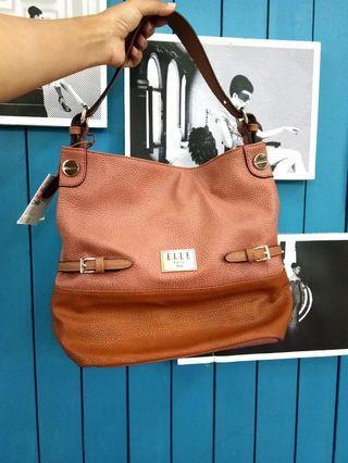 Mark down. Authentic Elle Mon Cheri handbag