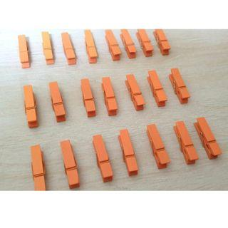 10 wooden orange pegs clips