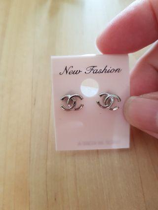 Silver ear studs