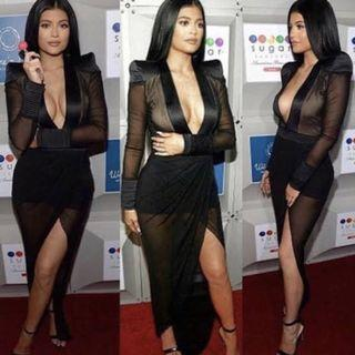 Kylie Jenner black deep V dress
