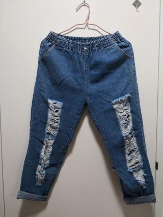 Elasticised waist band ripped jeans