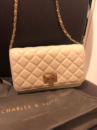 Charles & Keith sling bag . With dust bag . 20cm x 13cm .Kept unused . New. Bought at May 2019 with Rm239.9