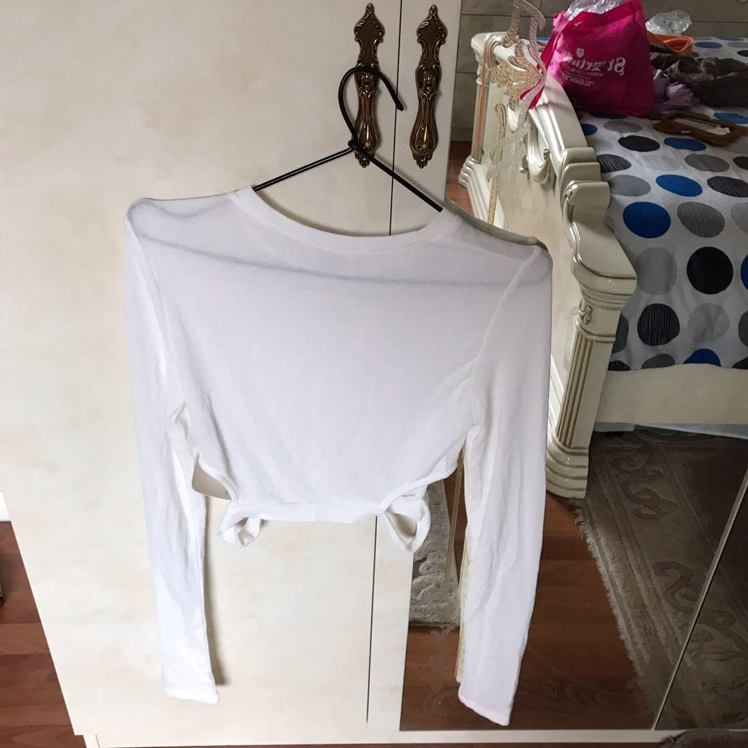 Tobi white cropped long sleeve knit top with side cut out - size small