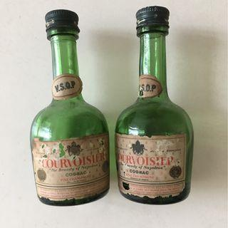 A pair of miniature antique Cognac (empty) bottles