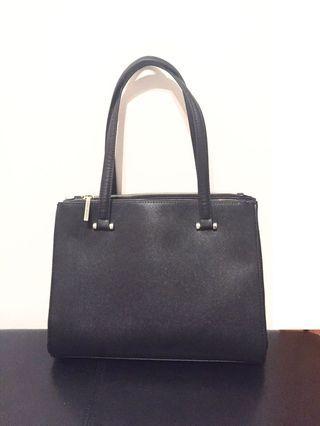 Designer handbag; Christian Siriano