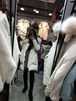 White winter down jacket with faux fur