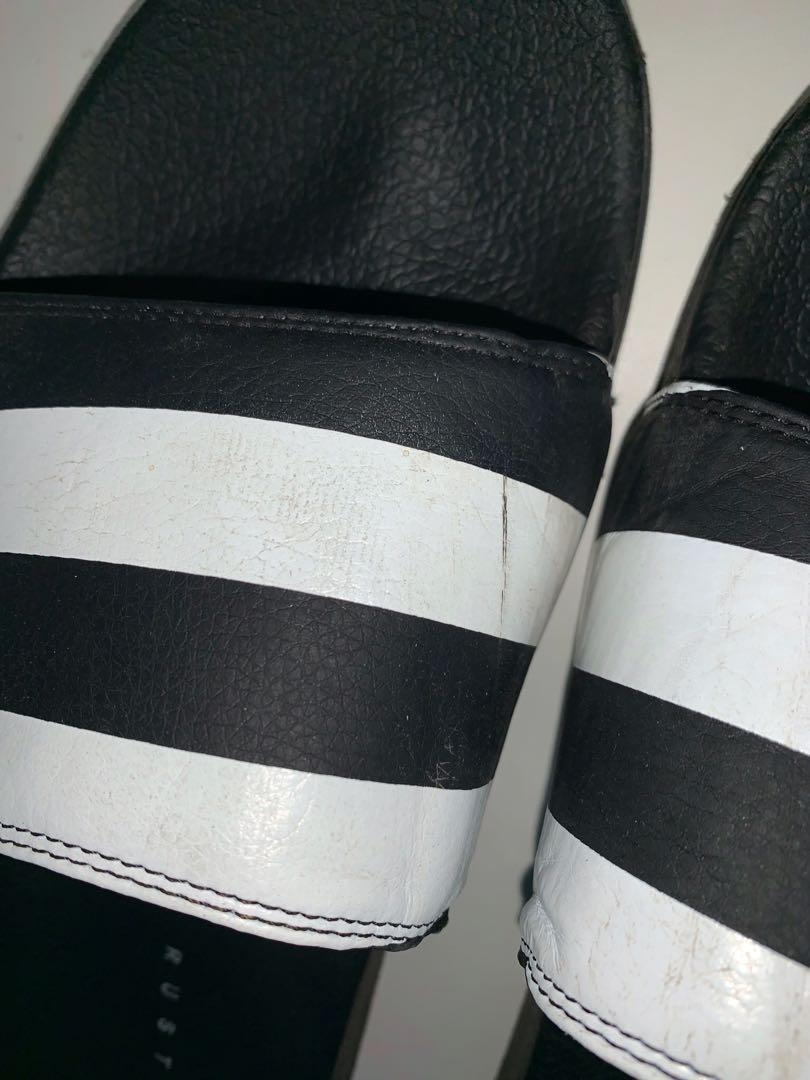 Black and white stripped Rusty slides   Great condition (besides the little scratch on the left shoe) only been worn on a week holiday.  Size - 8 womens