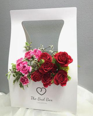 Red rose spray and pink carnation spray bloombox