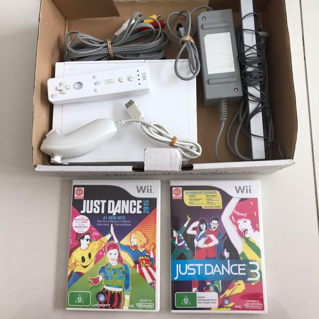 Nintendo white Wii console and just dance games