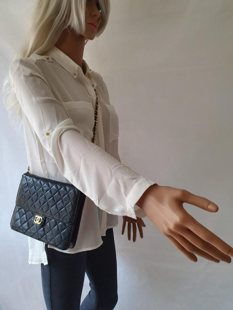 Authentic Chanel vintage quilted push lock black bag