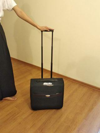 Crocodile luggage bag with roller