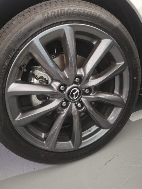 1 week old 18 inch mazda rim (as good as brand new)