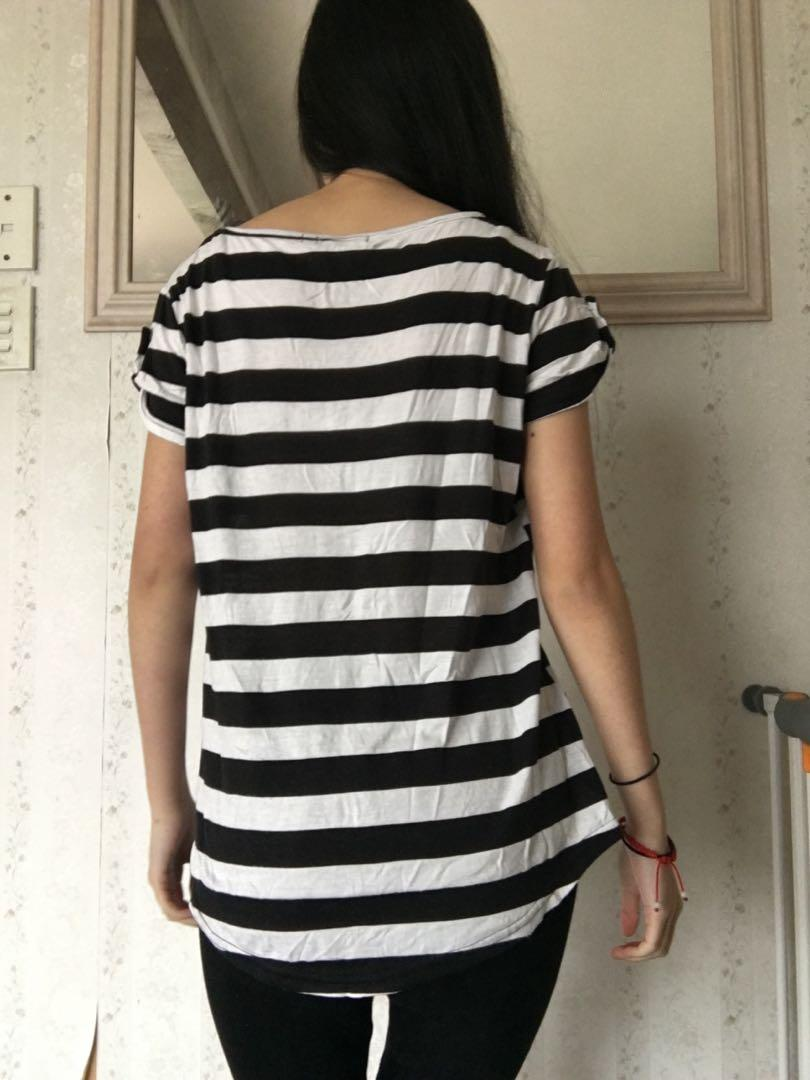 Simple t shirt Temt. Has cute button detailing on sleeves.