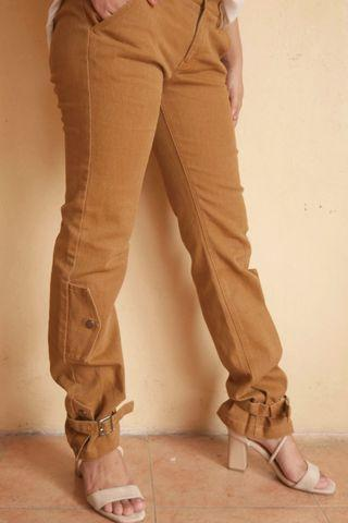 Rust denim jeans with buckles