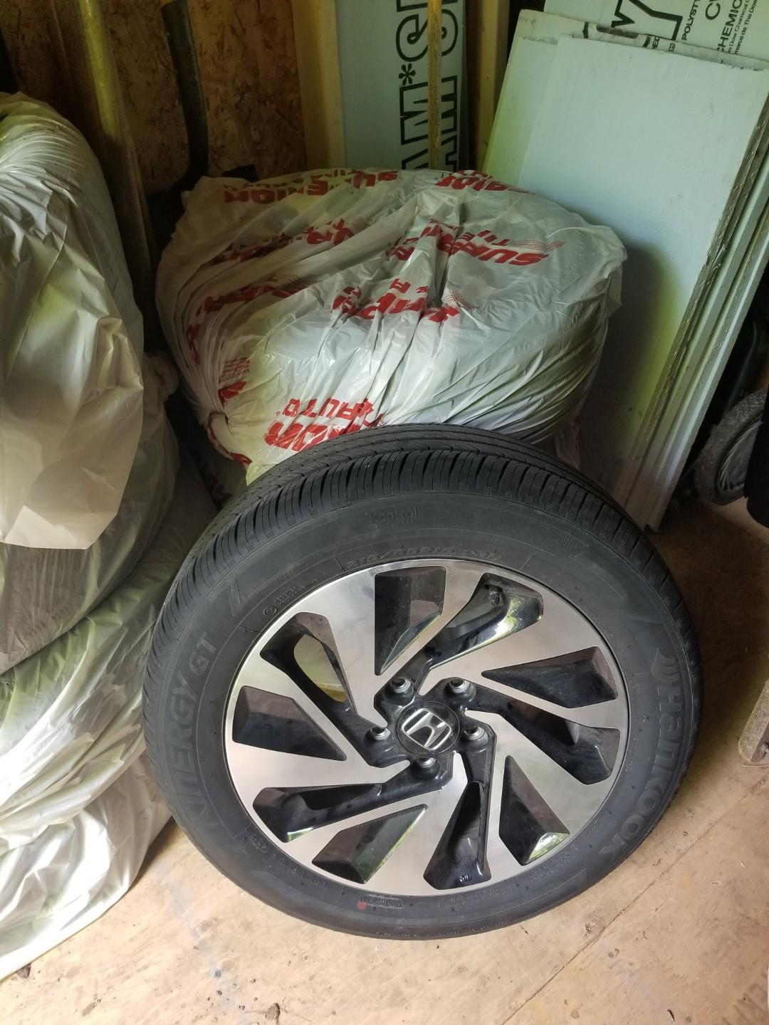 "OFFER 16"" honda civic OEM wheels with all season tires (9/10)"