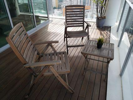 Wooden deck chairs and table set