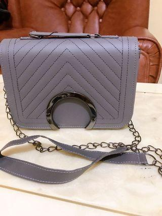 Sling bag grey / abu