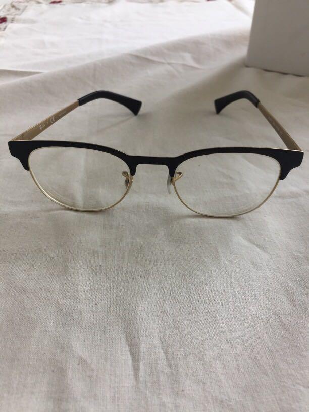 Black and gold Ray Ban frames