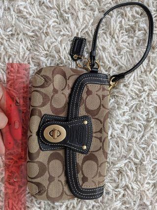 Coach monogrammed clutch wristlet purse