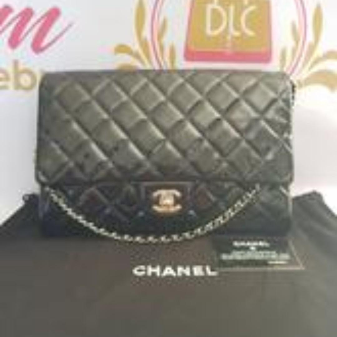 Authentic Chanel jumbo clutch black patent in silver hardware series 17