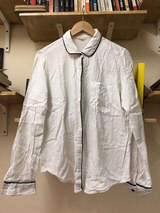 White shirt with black piping