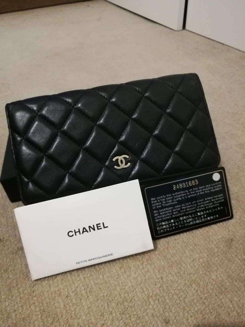 Authentic Chanel WOC Lambskin in Gold Excellent condition