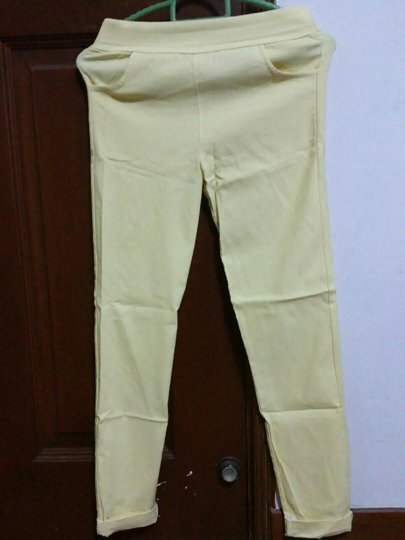 Woman yellow trousers