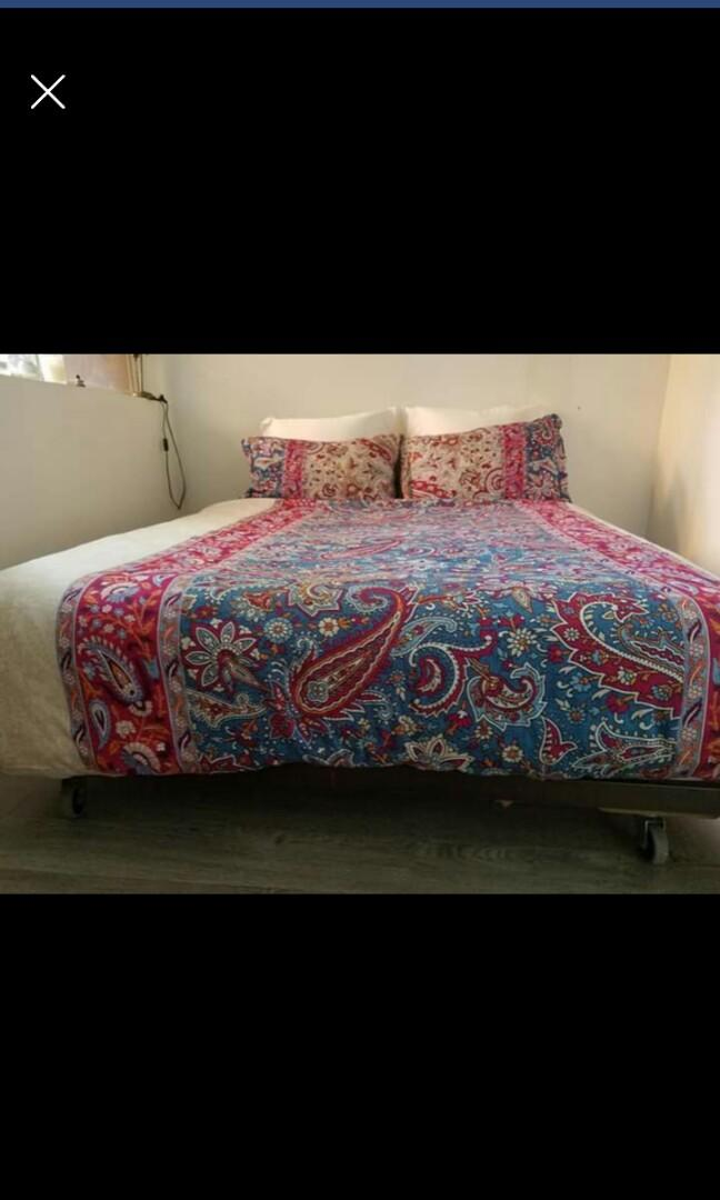 Good condition Queen bed with mattress and 2 bedside tables all on rollers