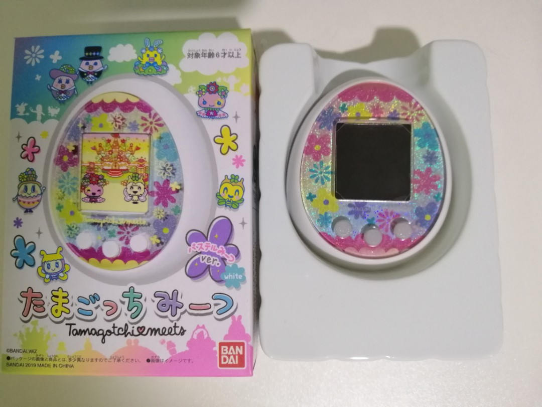 Becoming Phill) Tamagotchi meets english manual