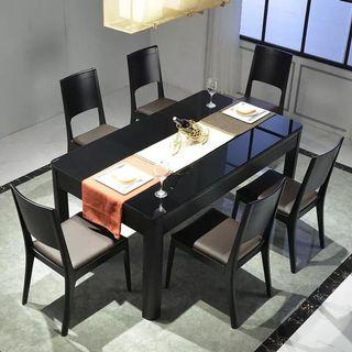 MODERN SIMPLICITY: Black Dining Table Set.