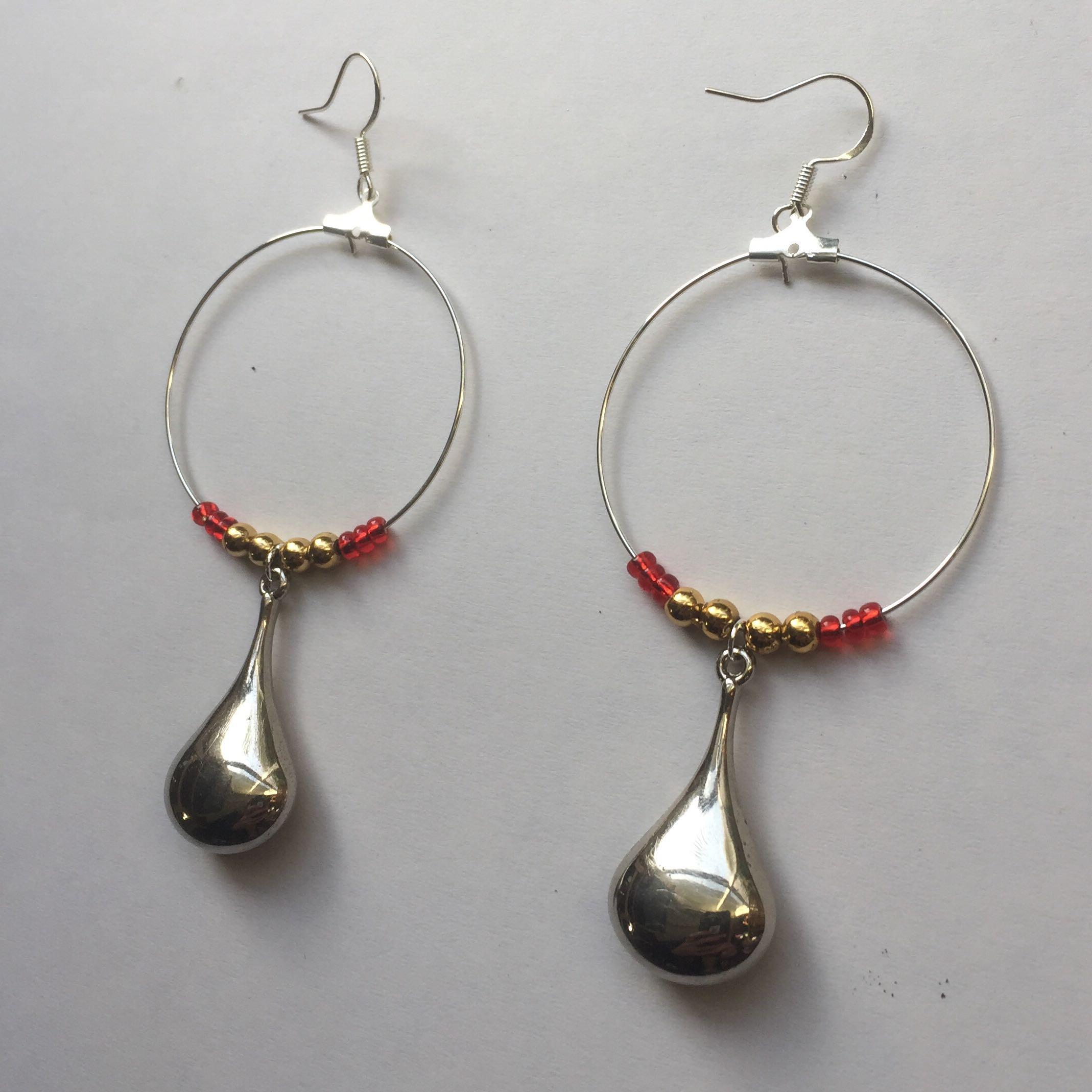 Silver pendant and red and gold beaded drop earrings