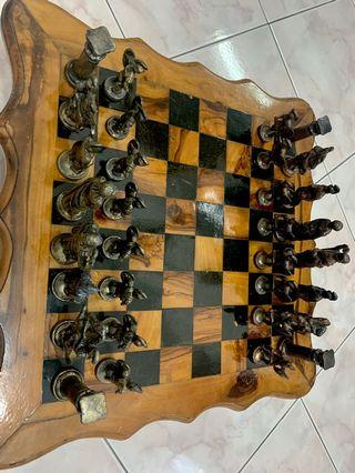 Roman chess pieces with wooden table