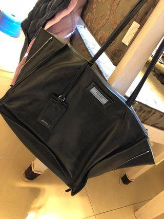 Prada black leather tote with blue inner lining