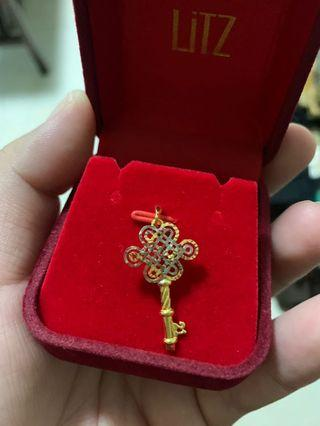 Gold key pendant
